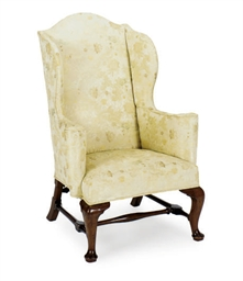 AN ENGLISH WALNUT WINGBACK ARM