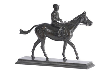 A BRONZE JOCKEY ON HORSE,