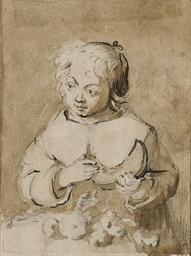 A little girl at a table holdi