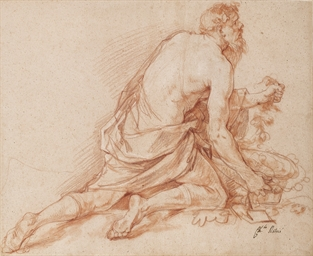 A kneeling man with a basket o