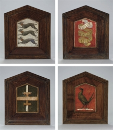 A set of four heraldic plaques