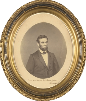 LINCOLN, Abraham. Oval portrait photograph INSCRIBED AND SIGNED, showing a bearded Lincoln. Taken by an unidentified photographer between March 1 and 30 June 1861. Probably inscribed and presented by Lincoln to Mrs. Speed on Thanksgiving Day, 28 November 1861.