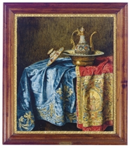 Still life of a decorative ewer and basin on textiles