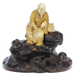 A JAPANESE CARVED IVORY FIGURE