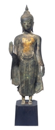 A THAI GILT BRONZE FIGURE OF A