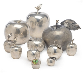 A GROUP OF NINE SILVER APPLE-F