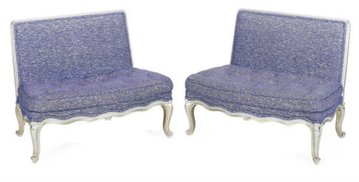 A PAIR OF SILVERED-WOOD AND CE
