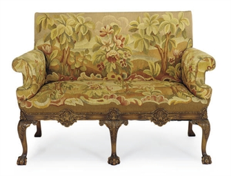 AN ENGLISH WALNUT SETTEE,