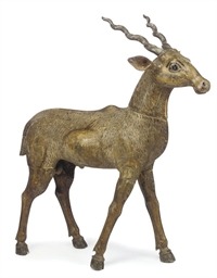 AN INDIAN WOOD MODEL OF A DEER
