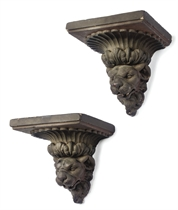 A PAIR OF REGENCY POLYCHROMED PLASTER WALL BRACKETS