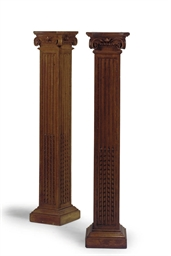 A PAIR OF CARVED OAK PEDESTAL