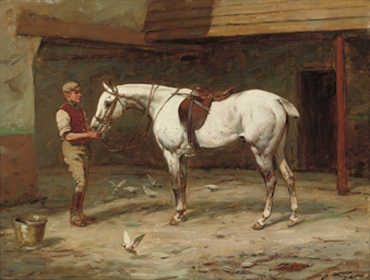 Grey hunter and groom in a sta