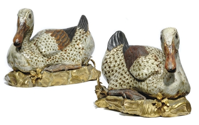 A PAIR OF ORMOLU MOUNTED POTTE