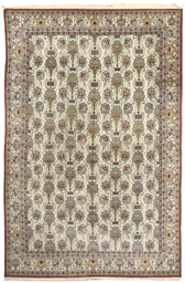 A FINE QUM CARPET, CENTRAL PER