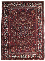 A FINE BAKHTIARI CARPET, WEST