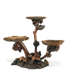 A JAPANESE BURR-WOOD TABLE DIS