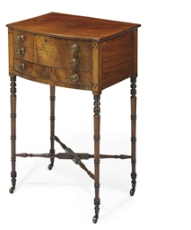 AN EARLY VICTORIAN MAHOGANY AND EBONISED BOWED WORK TABLE