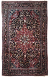 A FINE LARGE KASHAN CARPET
