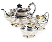 A LATE VICTORIAN SILVER THREE-PIECE BACHELOR'S TEA SET