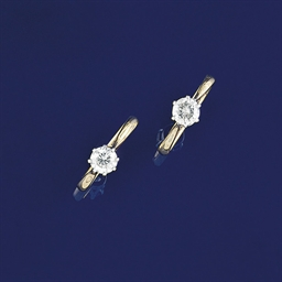 Two diamond single stone rings