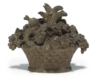 A FRENCH TERRACOTTA FLOWER AND