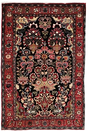 A fine Sarouk rug & part silk