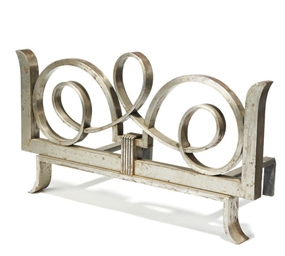 A POLISHED STEEL ANDIRON, ATTR
