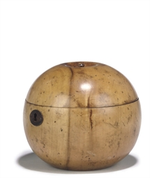 A FRUITWOOD APPLE-SHAPED TEA C