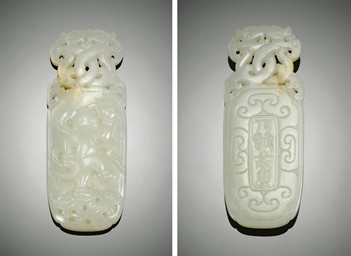 A FINELY CARVED WHITE JADE ELO