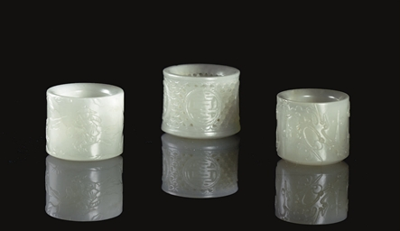 THREE WHITE JADE THUMB RINGS