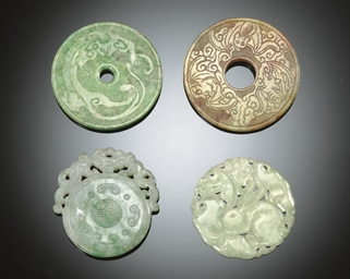 FOUR JADEITE CIRULAR CARVINGS