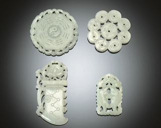FOUR WHITE JADE PENDANTS