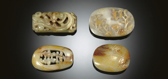 THREE CARVED JADE BELT BUCKLES