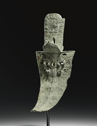 A VERY RARE BRONZE DAGGER-AXE,