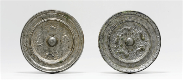TWO SILVERY BRONZE MIRRORS