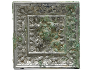 A SILVERY BRONZE SQUARE LION A
