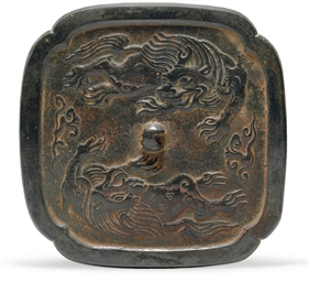 AN UNUSUAL BRONZE SQUARE MIRRO