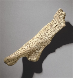 A RARE CARVED BONE FRAGMENT