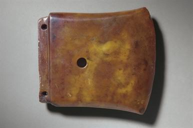 A MOTTLED RUSSET BROWN JADE AX