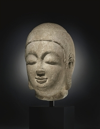 A GREY STONE HEAD OF BUDDHA