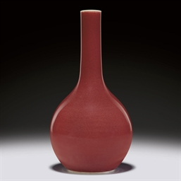 A COPPER-RED-GLAZED BOTTLE VAS