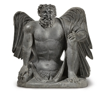 A gray schist figure of a winged Atlas