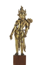 A gilt copper figure of Padmapani