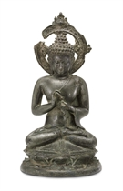 A bronze figure of a Teaching Buddha