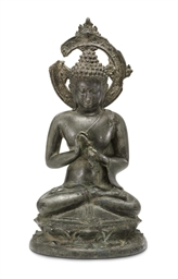 A bronze figure of a Teaching