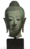 A bronze head of Buddha