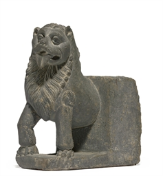 A gray schist figure of a lion