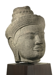 A sandstone head of a Dvarapal