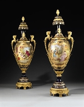 A PAIR OF ORMOLU-MOUNTED SEVRES STYLE COBALT-BLUE GROUND VASES AND COVERS