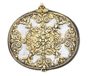 A SILVER-GILT MOUNTED MIRROR